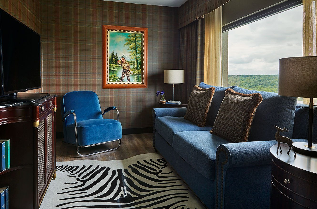 sitting area with large couch in graduate ann arbor suite
