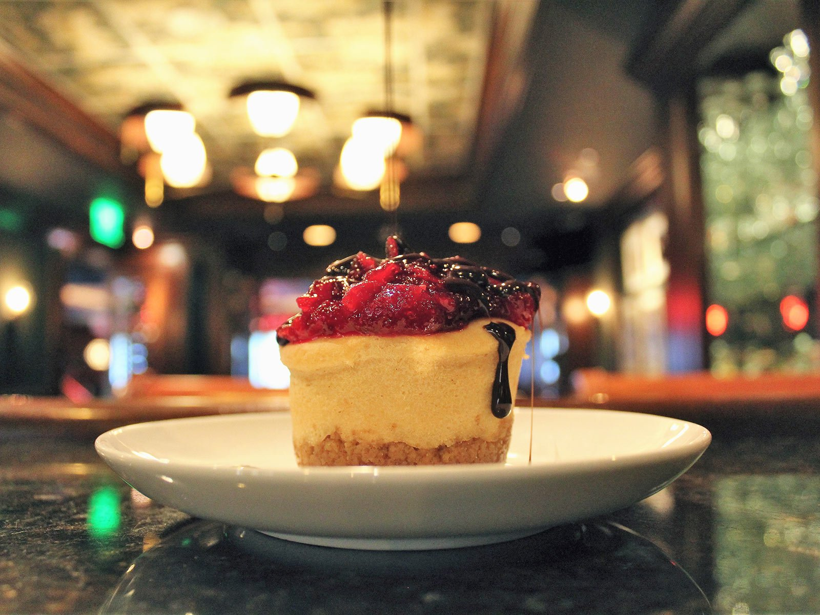 Delicious Cheesecake topped with berry compote
