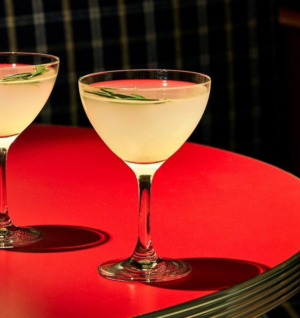 Two cocktails on a table