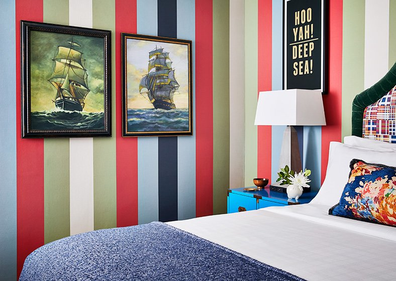 Guest room with colorful striped walls