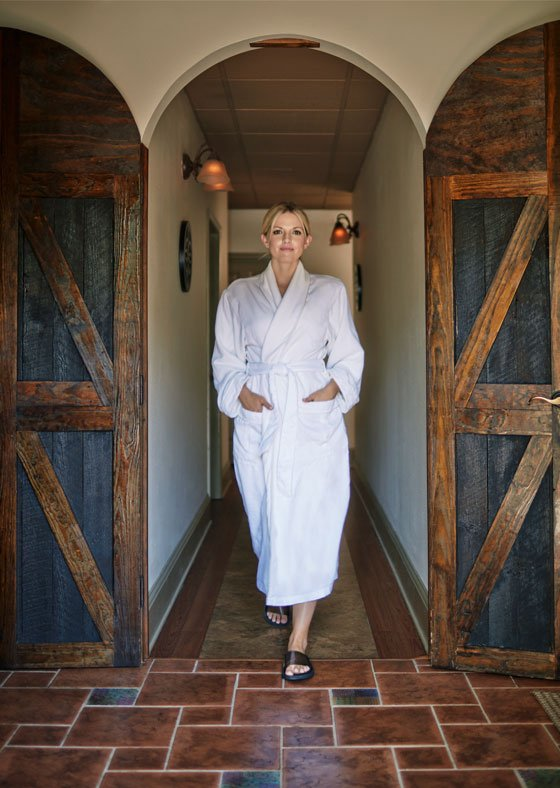 woman walking out of the graduate athens spa in a bathrobe