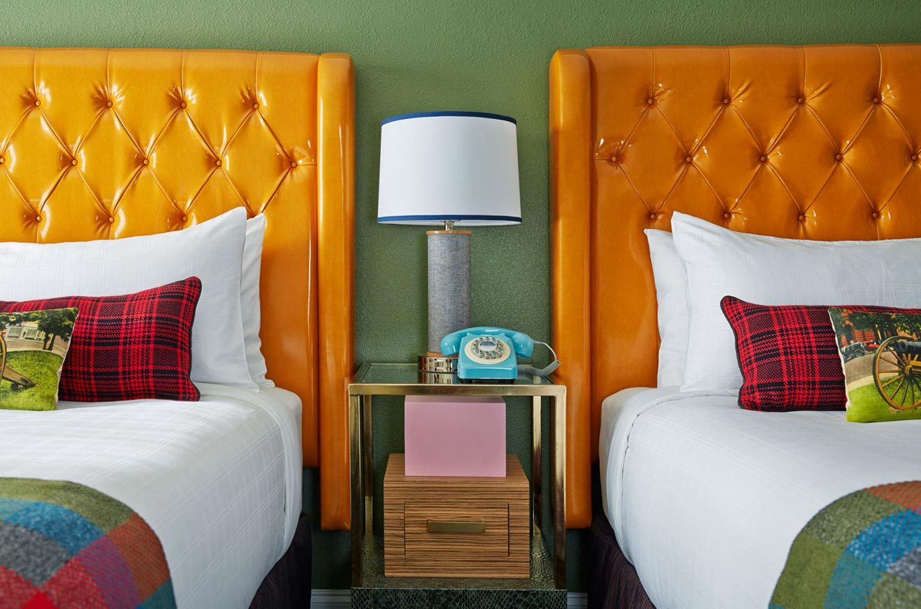 double queen room with middle table and lamp
