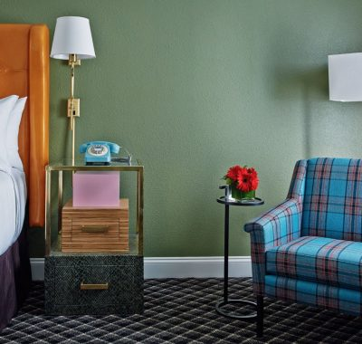plaid patterned chair with side table and lamp