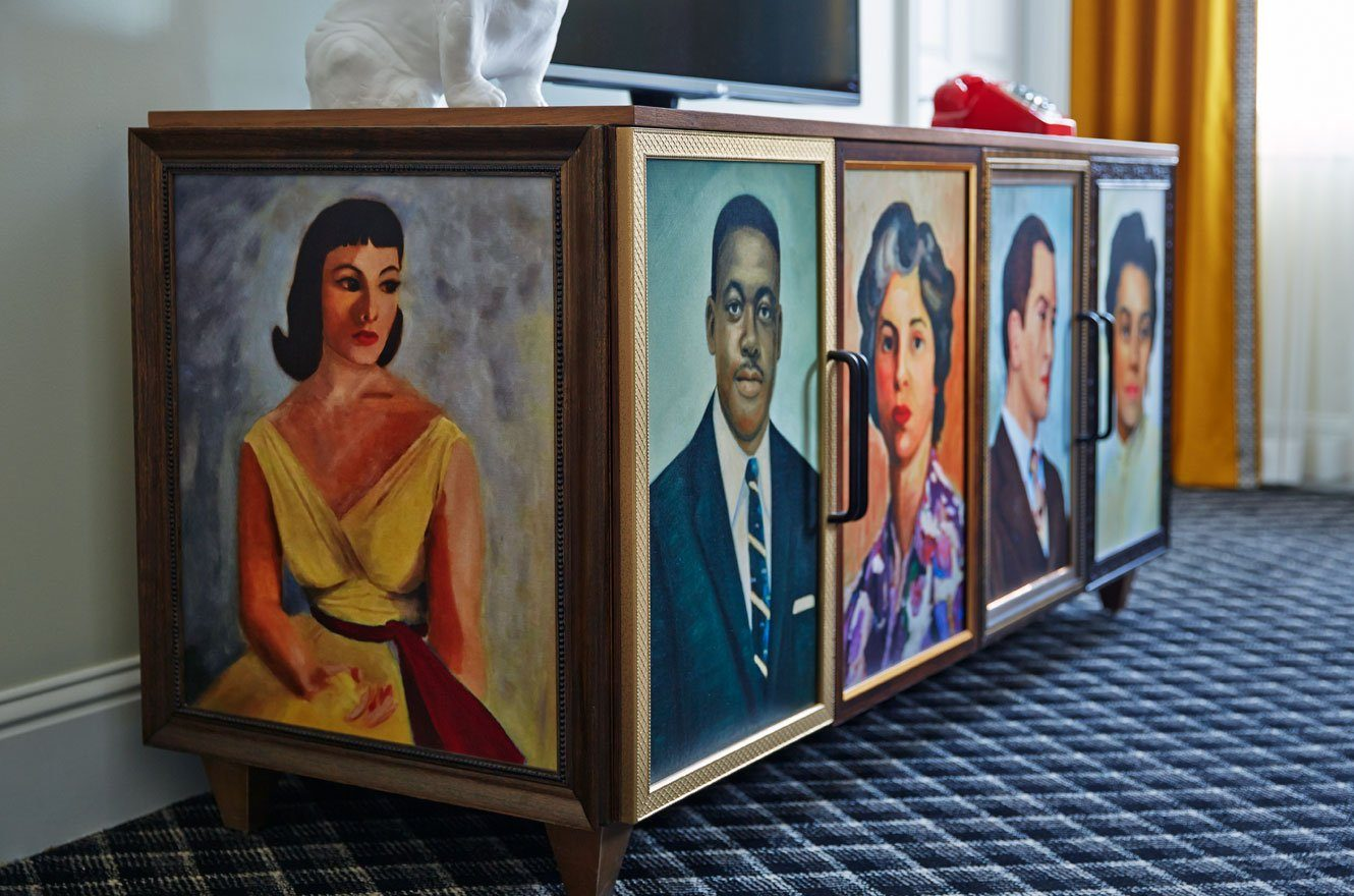 dresser with faces painted on it
