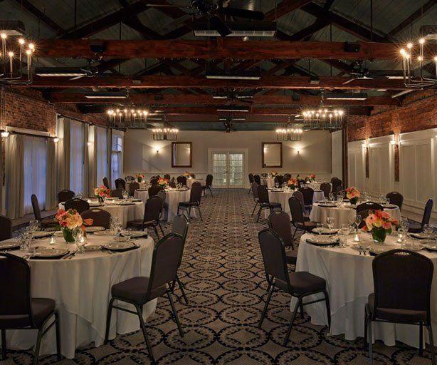 open ballroom with wedding reception tables setup