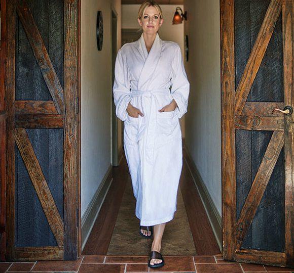 woman walking in a robe
