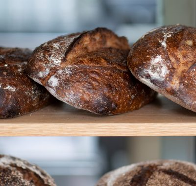 Loaves of bread on a shelf