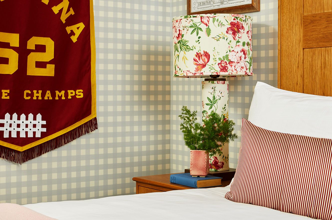 A floral lamp, hotel bed and Indiana banner