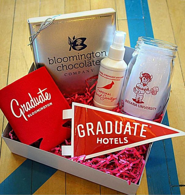 Local Love box from Graduate Bloomington, including chocolates from Bloomington Chocolate Company, hand sanitizer from Cardinal Distillery, a mason jar from Nick's English Hut, and Graduate koozie/pennant