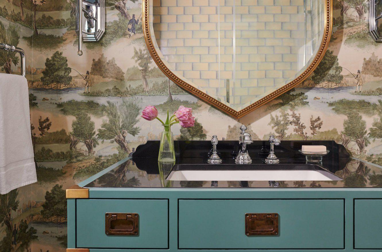 bathroom vanity and mirror in guestroom