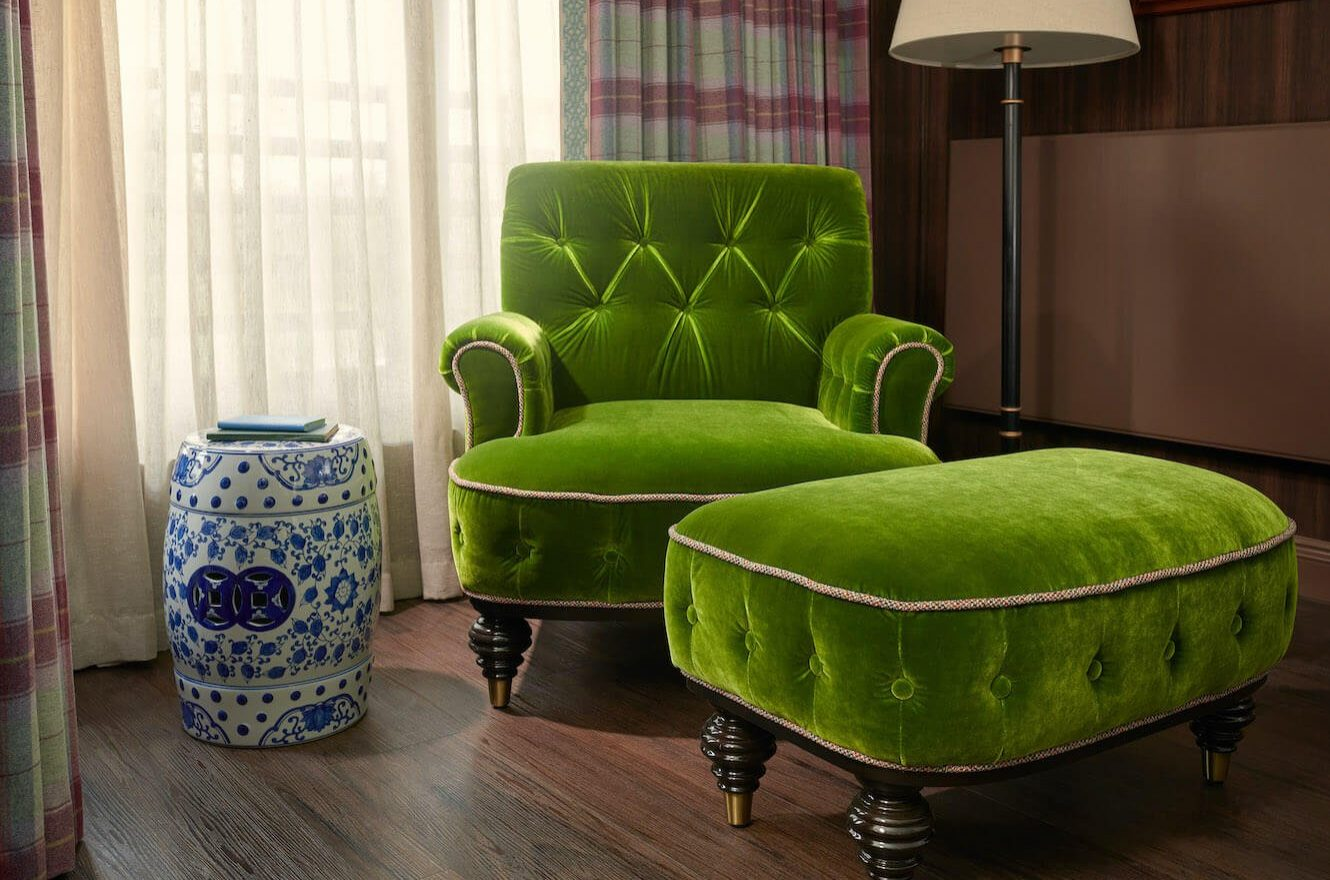 Sitting chair with side table in guest room
