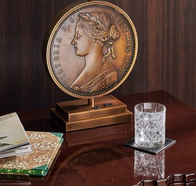 desk with Victoria coin lamp