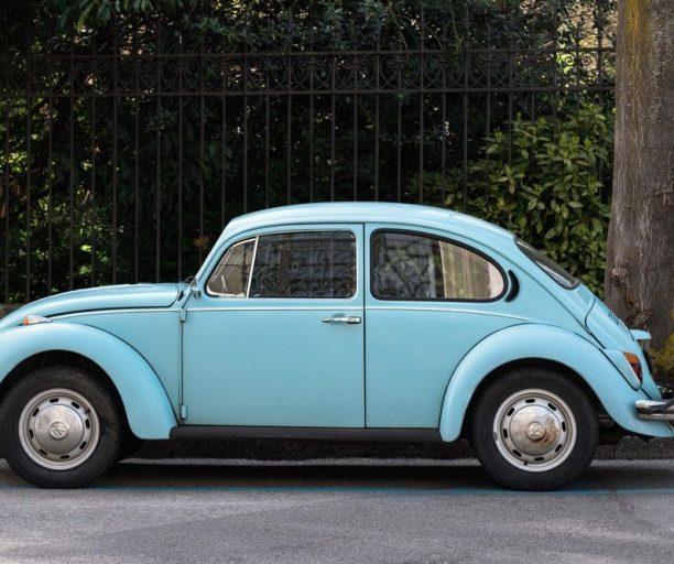 light blue Volkswagen Beatle