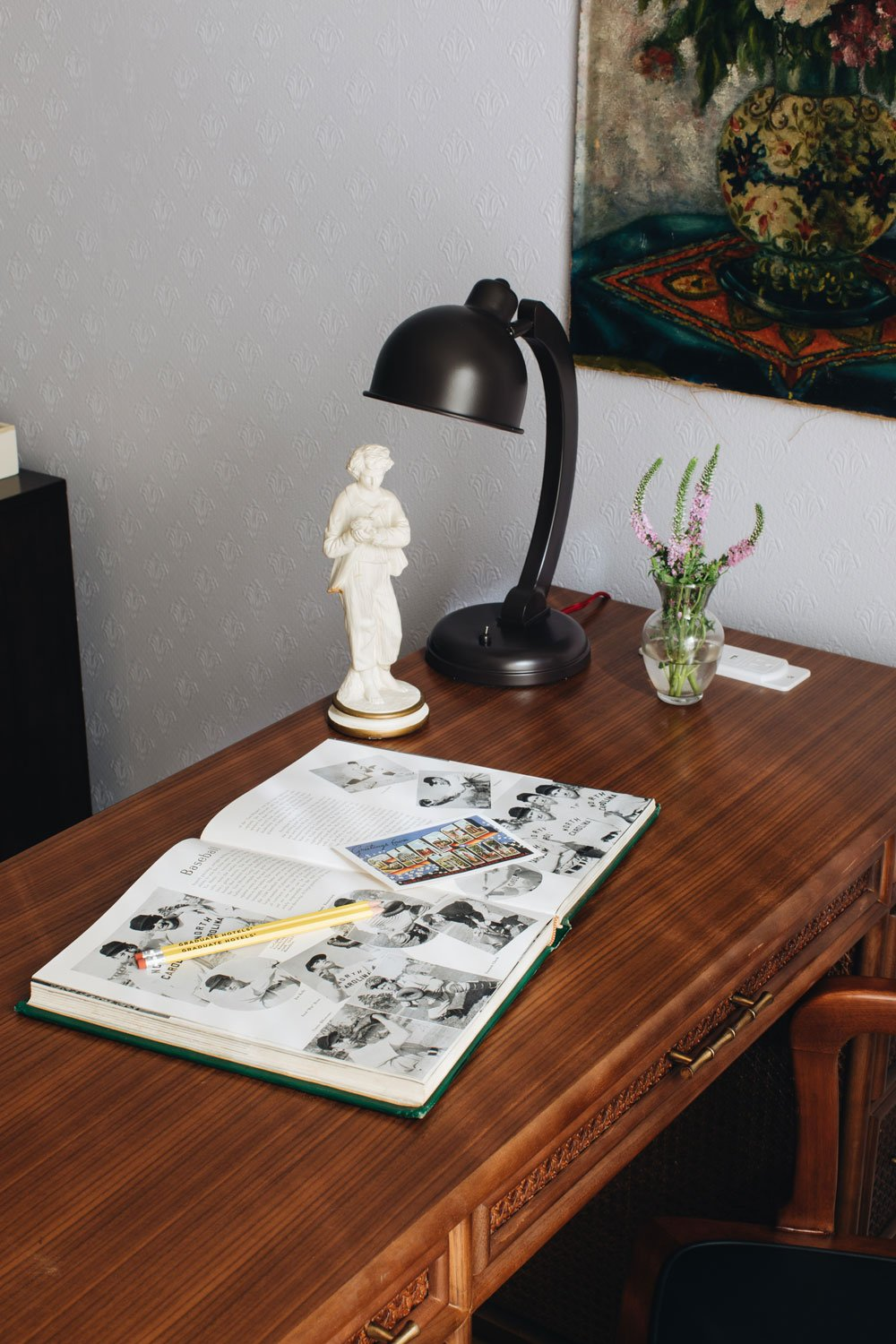 Desk with magazine and lamp