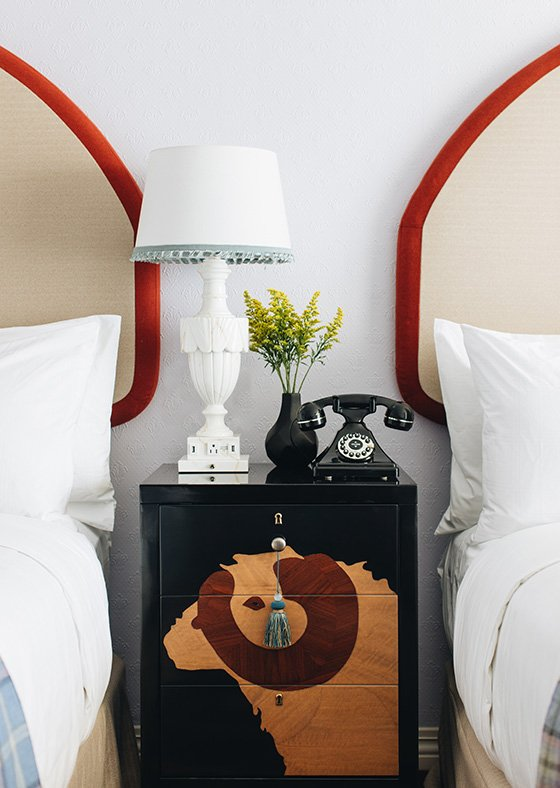 Bedside table with lamp and vintage phone