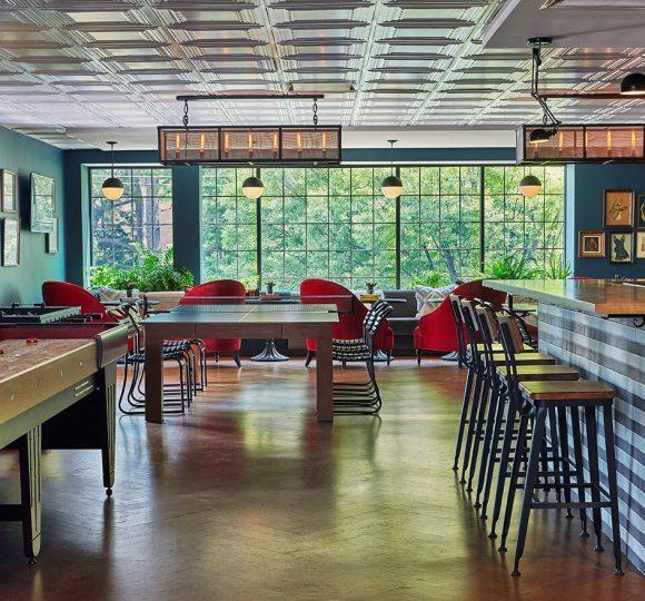 shuffle board and ping pong table at sheepdog cafe
