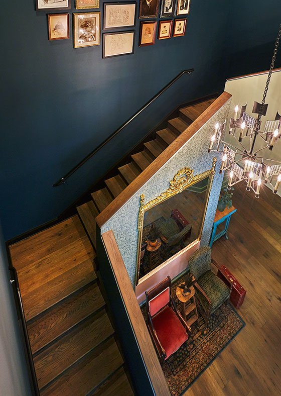 Birdseye view of historic staircase with overhanging glass chandelier in Graduate Charlottesville