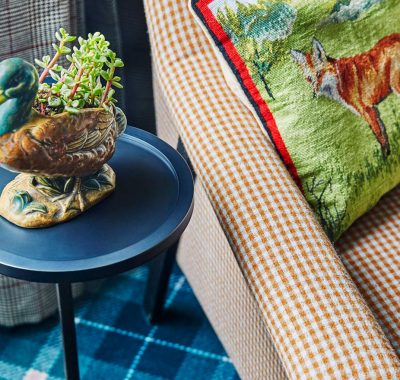 Animal themed decorations next to classic fabric furniture