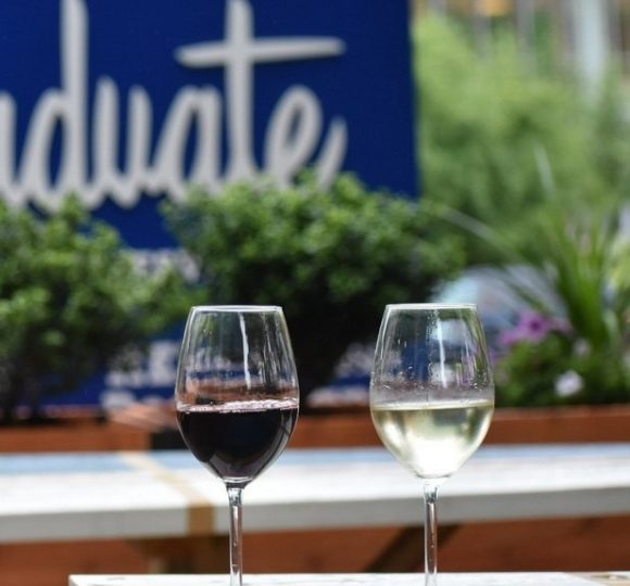 2 glasses of red and white wine at Heirloom Rooftop & Bar
