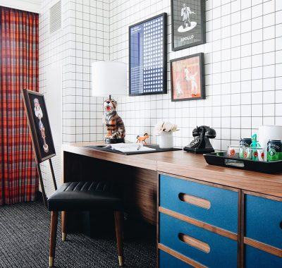 Office desk against a wall near a window