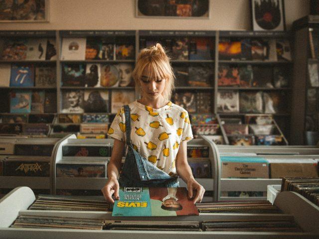 girl looking at records