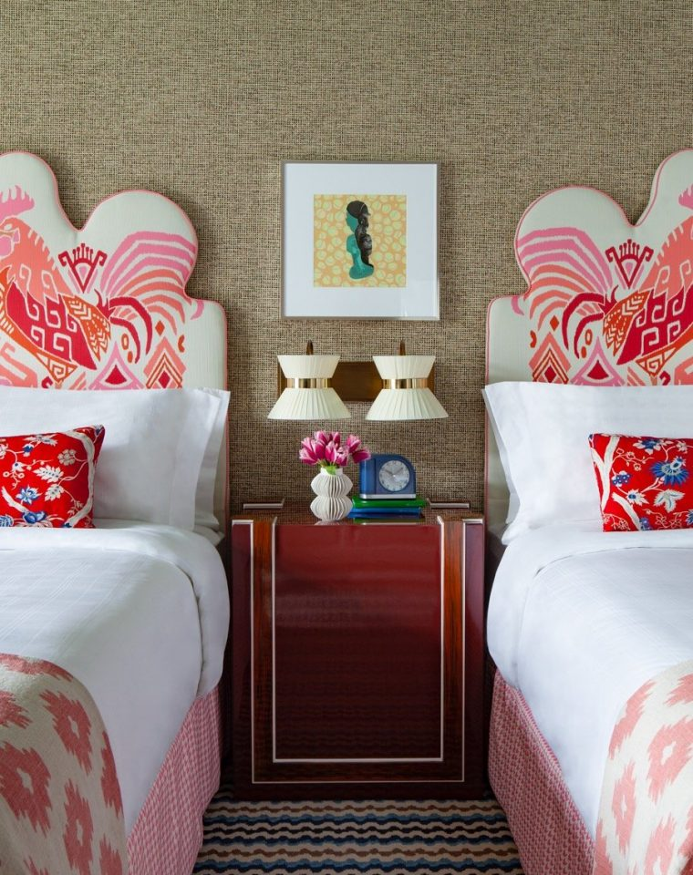 Two beds with a view of the rooster headboard