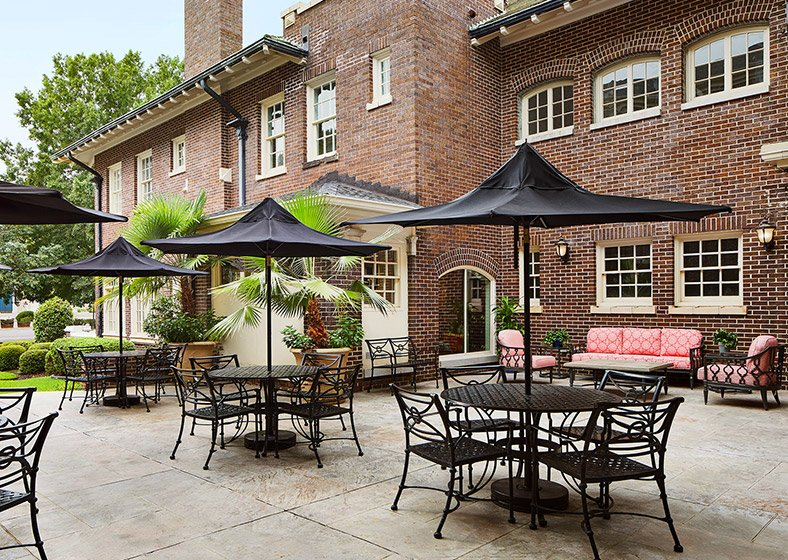 External patio area with outdoor furniture and umbrellas