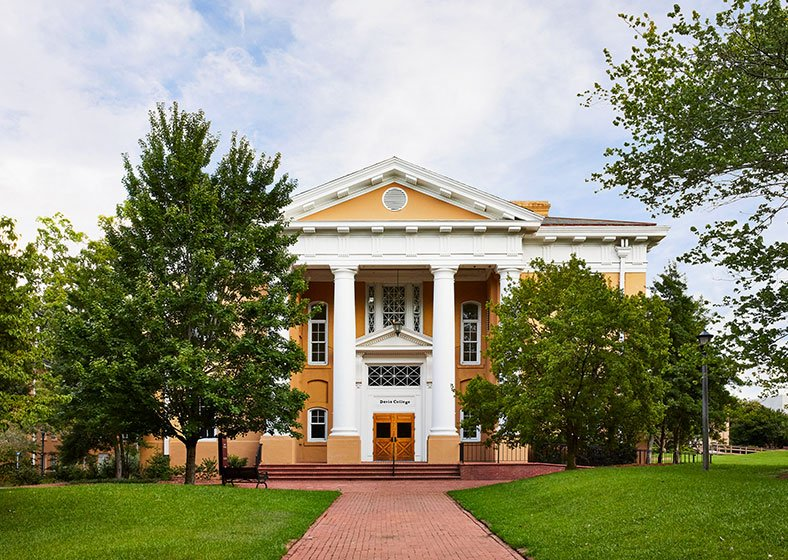 Davis College building with a yellow facade and white pillars