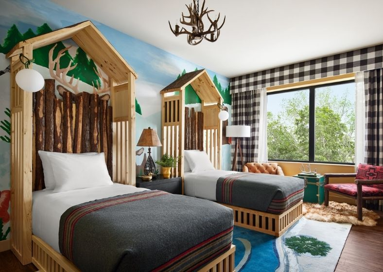 Cabin-themed beds in the family suite at Graduate East Lansing