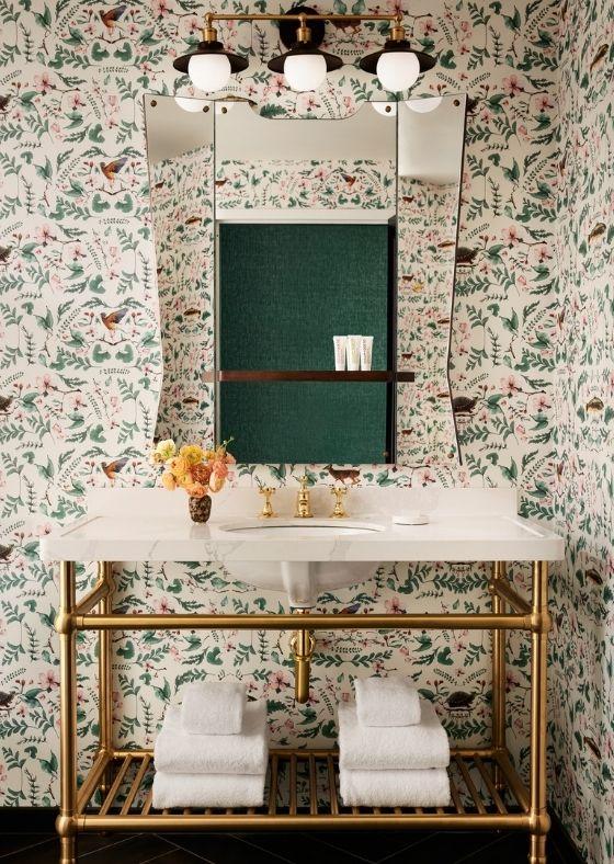 Unique floral wallpaper and vanity in in-room bathroom