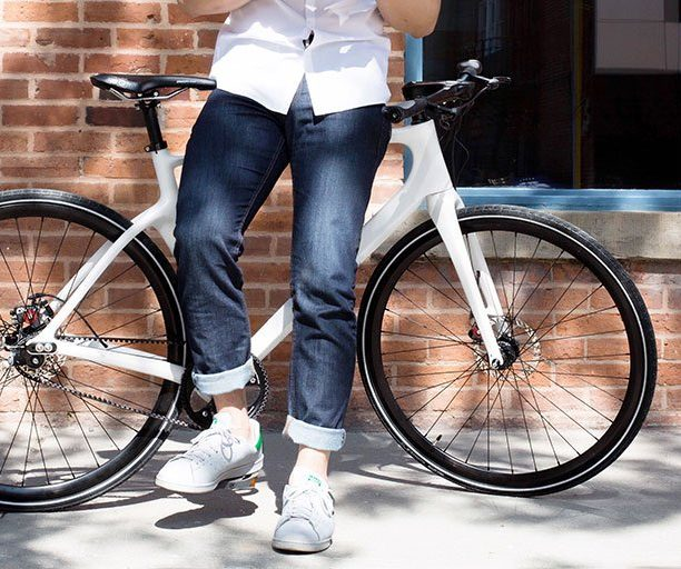 Person leaning against a bicycle