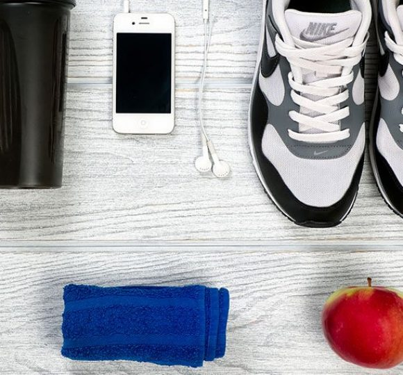 shoes with phone, towel and apple
