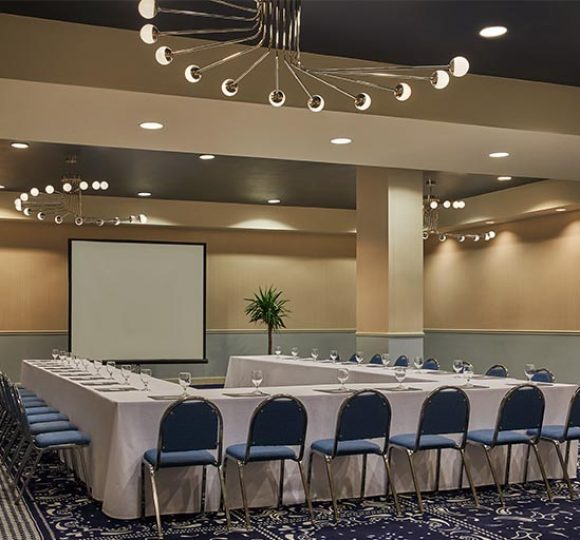A U-shaped table with chairs in the Perkins room