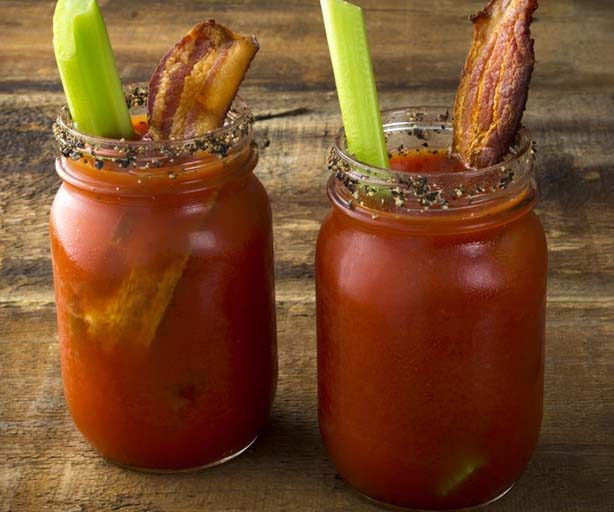 two bloody mary's in glass jars