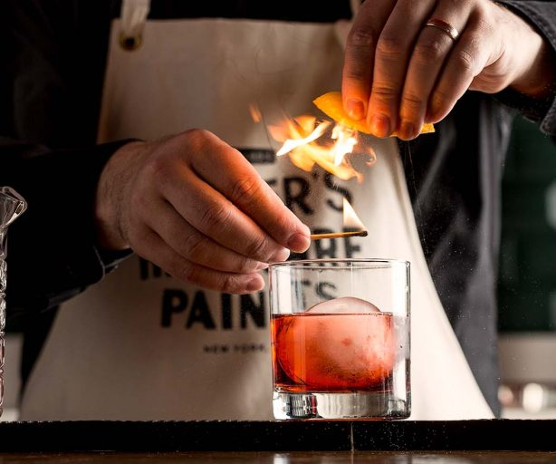 a chef making a cocktail