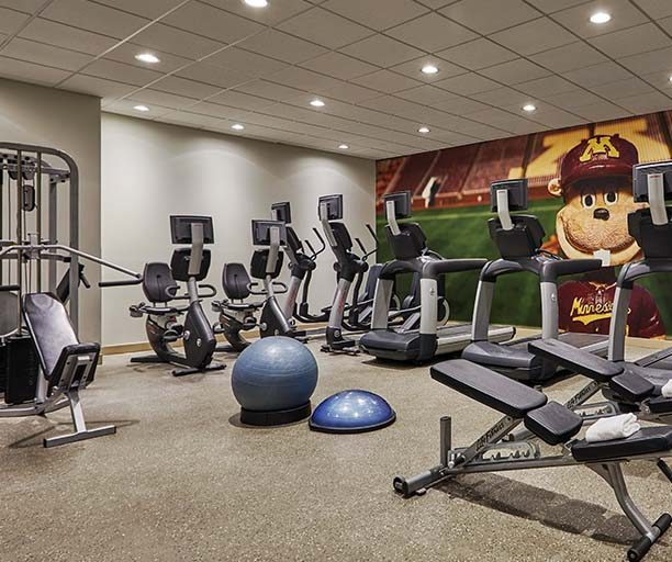graduate minneapolis fitness center with treadmills and weights