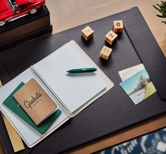 desk with a notebook and letter squares on top