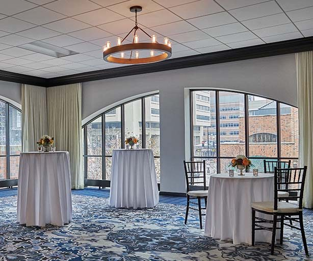 formal tables setup in front of a large window at graduate minneapolis