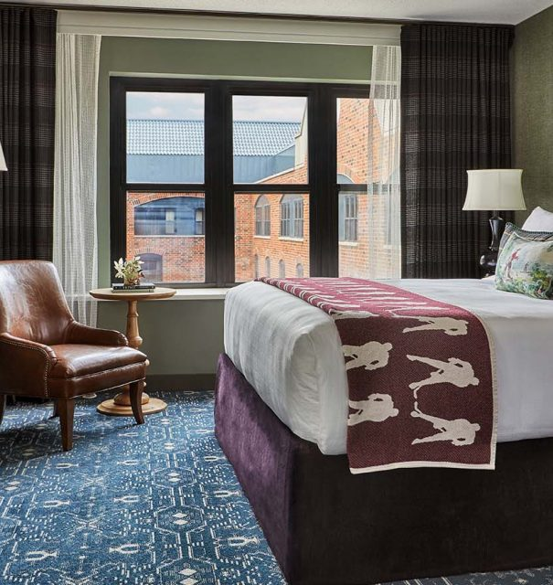 king bed in presidential suite at graduate minneapolis