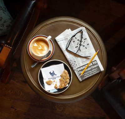Coffee and cookies on a table