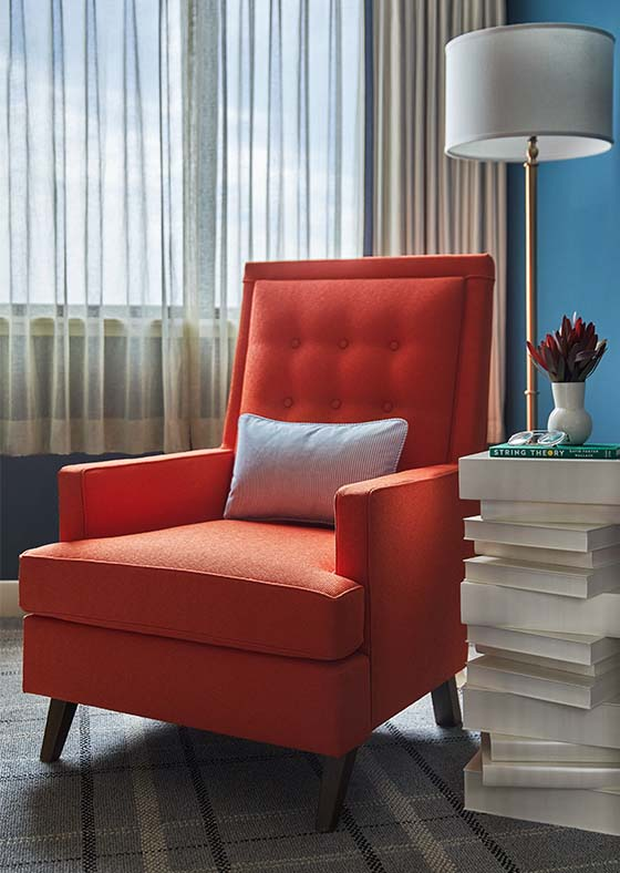 Corner accent chair in Graduate Richmond guestroom