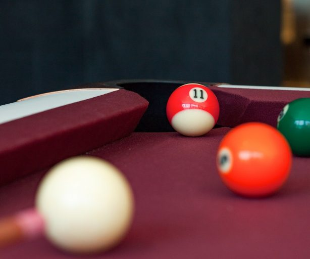 Billiards table with balls in Graduate Richmond Game Room