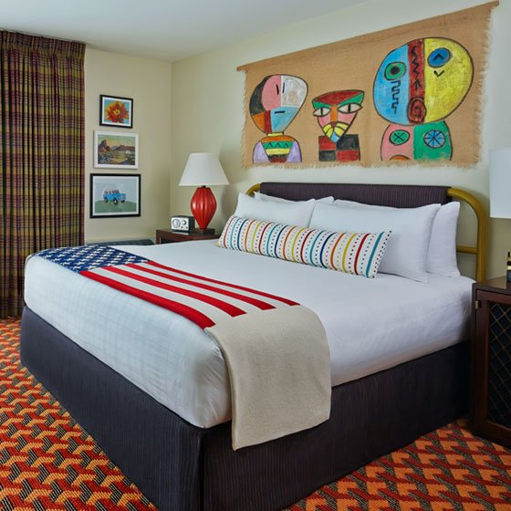 Giant king sized bed with American flag bedspread