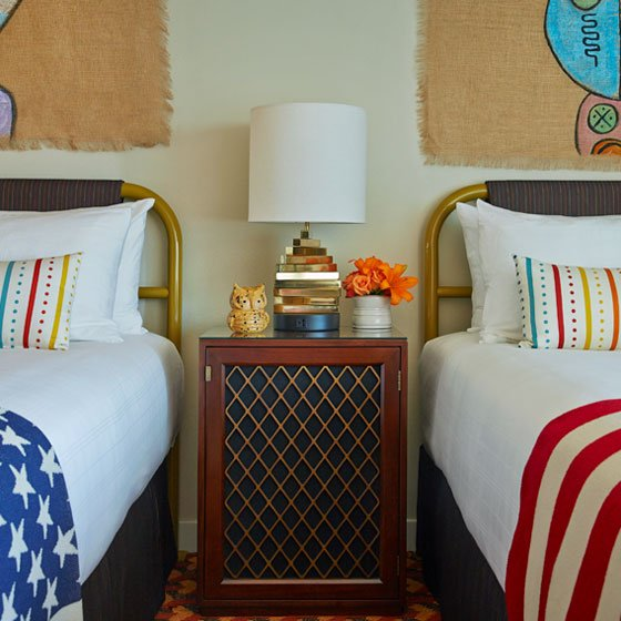 Queen queen room and night stand at the Graduate Tempe