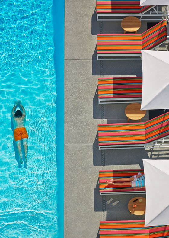 Someone swimming at Graduate Tempe's rooftop pool