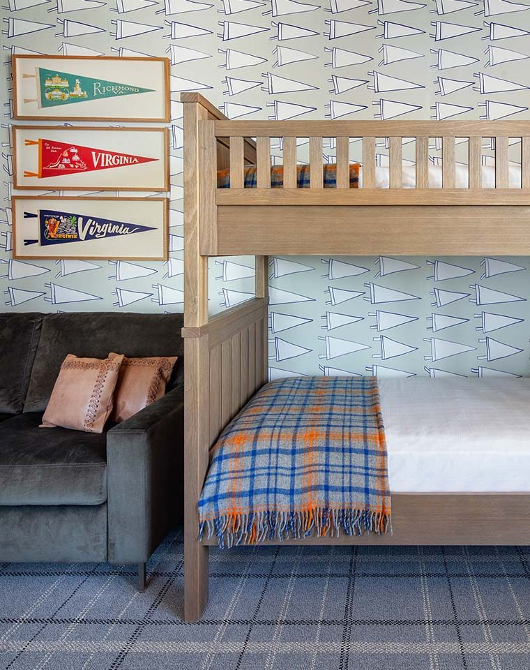 Bunk bed with Graduate wallpaper in the background