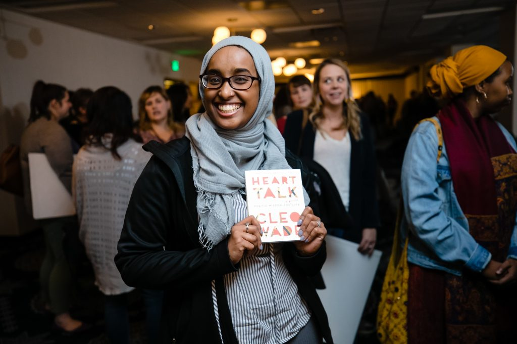 Women holding a copy of Cleo Wade's book Heart Talk