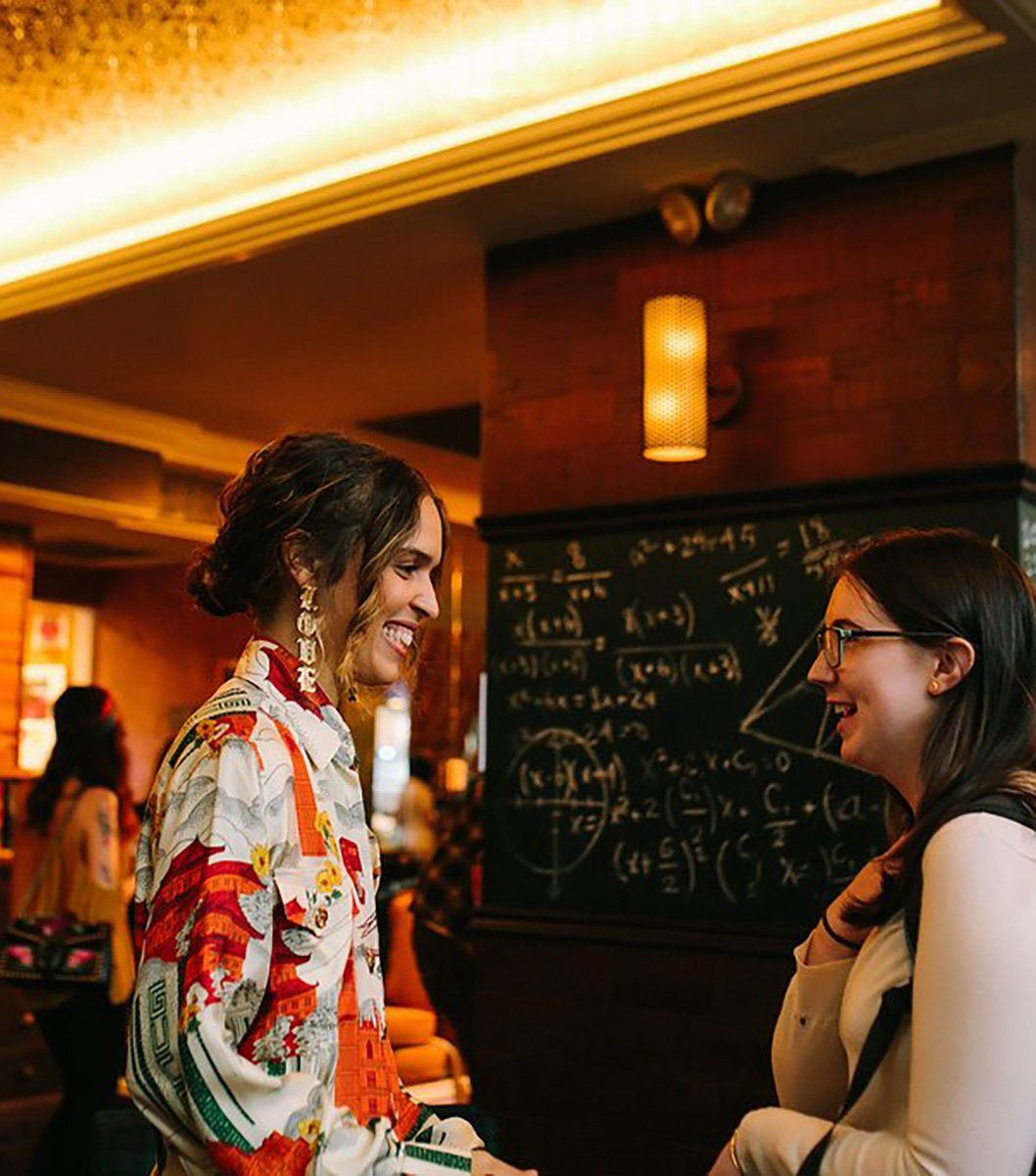 Cleo Wade talking with a fan at her event at Graduate Ann Arbor.