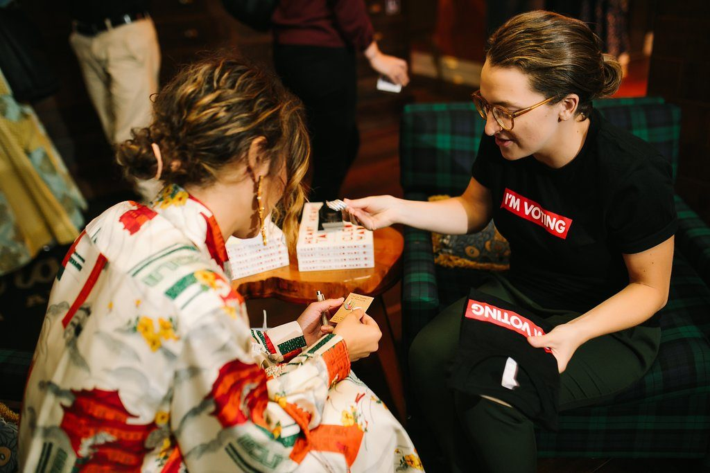 Cleo Wade learns about the I'm Voting campaign from a volunteer at her event at Graduate Ann Arbor.