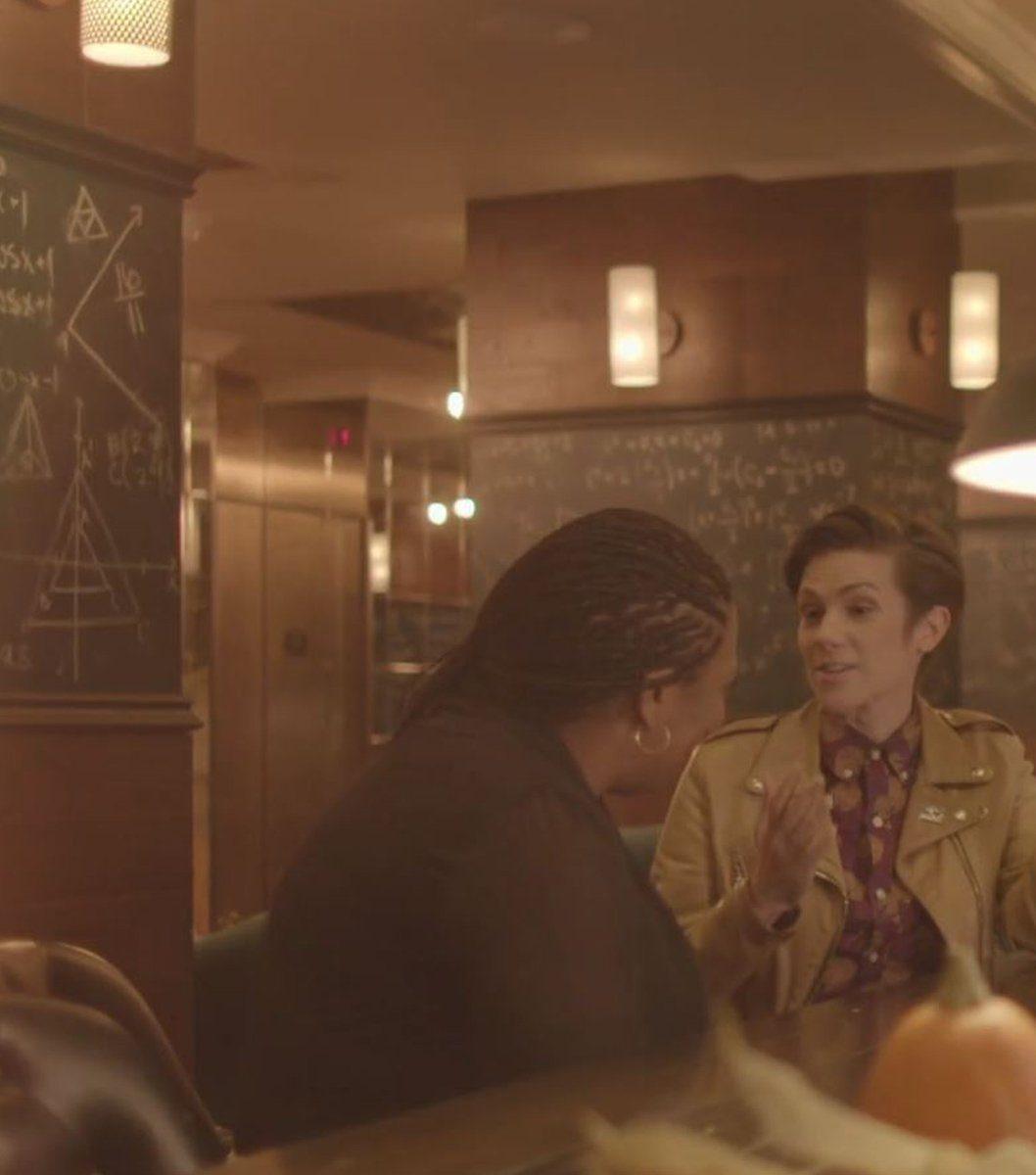 Cameron Esposito talking with Imani Rupert-Gordon in the lobby of Graduate Ann Arbor